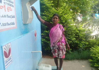 A rural woman using water ATM in Telanana